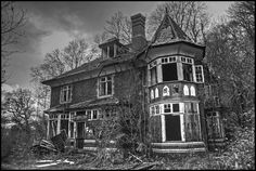 Spooky Manor    A new urbex location for me but for the third time in a row I have  been beaten to it by the arsonists. The top floor was totally burnt  out and inaccessible.Single exposure converted to mono with Photomatix HDR software.