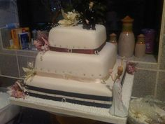 My First Ever 3 tier cake, for my own wedding. Never had a lesson in my life, just read a few bits from a book. Its not perfect, LOTS I would change now, but was great fun.