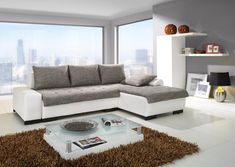 Minimalist Gray and White Living Room Design with Brown Feather Rug Ideas and Modern White Sofa Frame also Beautiful Outdoor Views for Stunning Living Room Design with Modern Furniture