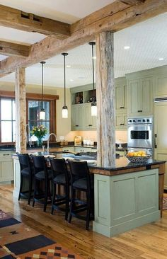 Wood and sage green cabinets design