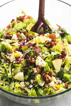 Fresh, chopped Autumn salad with apple cider dressing has crunchy candied cinnamon pecans, apples, pears, bacon and feta cheese.