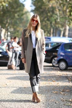 How To Dress Like An Italian Girl — 50+ Lessons Worth Knowing #refinery29  http://www.refinery29.com/2014/09/74945/milan-fashion-week-2014-street-style#slide78  Stovepipe jeans get a little European upgrade with snakeskin booties and a blazer coat.