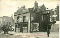 Vine Tavern, Mile End -  (it is the building behind the horse and cart)