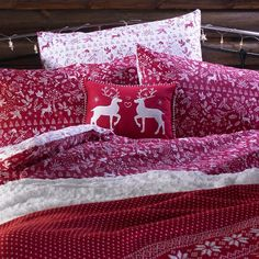 Stag print duvet set £16, stag print throw £20, cream rosebud throw £15