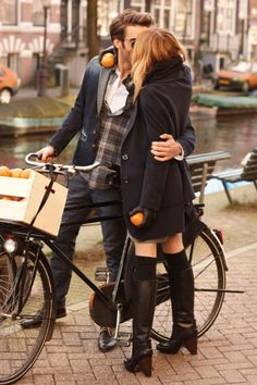 I love these sophisticated outfits for the city backdrop. Oranges on a bike