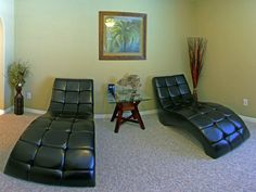 Relax in one of the two chaise loungers in the den.  Den also includes desk and office chair.