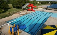 Splash into the cool Fairview Aquatic Center via the two diving boards or two winding slides. Bring the kids to this Oklahoma public pool for a full dose of summer fun.