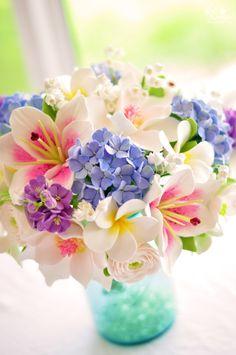 DK Designs - Southern Inspired wedding bouquet. Stargazers, hydrangeas, stock flowers, magnolias, dogwoods, lily of the valley, ranunculus, plumeria.