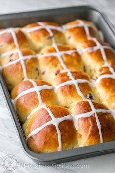 These Hot Cross Buns are lightly spiced with cinnamon and nutmeg and studded with tangy craisins or raisins. They are great for Easter or a Good Friday.