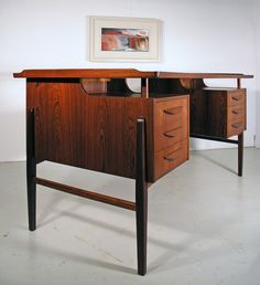 Svend Madsen Danish rosewood desk | From a unique collection of antique and modern desks at https://www.1stdibs.com/furniture/storage-case-pieces/desks/