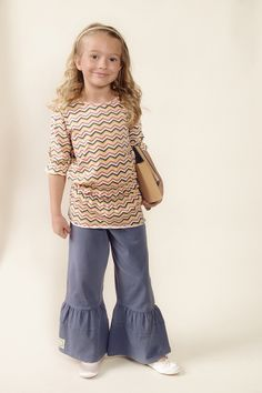 Vermont Childrens Clothing Boutique Looks like Anna, sweet. Just right for getting off to school.