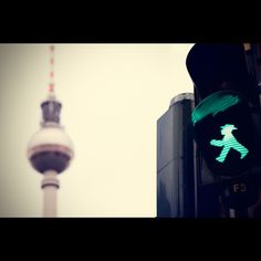 East Berlin pedestrian crossing ampelmann and in the background, the Fernsehturm (TV Tower)