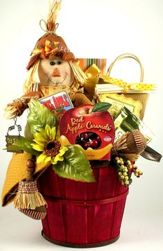 How cute is this?!  Bushels of Fun Fall Gift Basket  Our festive Bushels of Fun Fall Gift Basket comes with a fabulously fun and totally adorable scarecrow and is filled with a fantastic selection of flavorful gourmet Fall favorites!  Send them more than a gift this Fall this wonderfully whimsical basket that offers a unique hand-painted bushed basket with leather side handles!  $79.99    http://www.littlegiftbasketboutique.com/item_890/Bushels-of-Fun-Fall-Gift-Basket.htm