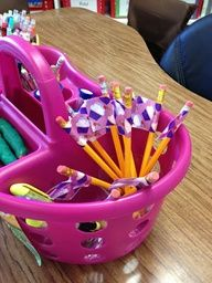 Add duct tape to pencils to keep them from disappearing :) Colors can match the color of the table. Easy to see where pencils belong and all tables have enough.