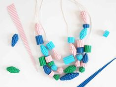Create beads using pieces of colorful corrugated cardboard.