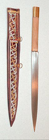A sax is a short sword that was used primarily during the early part of the Viking era. It's a one handed single edged weapon with a blade length ranging from 30 to 60cm (12 to 24 in). Saxes usually had simple fittings and no crossguard. Hilts were made of wood, bone, or horn. This photo shows a reproduction sax based on an historical 8th century sax found in the Netherlands.