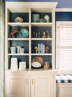 Add a Textured Back Panel - Easy Ways to Style Your Bookshelves Like the Pros on HGTV