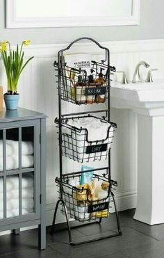 This Market Basket Stand is the practical and elegant storage solution that will bring organization to any room of the house. Each of the 3 generous-sized baskets is ideal for holding everythi (Diy Bathroom Dollar Stores) Bathroom Storage Shelves, Bathroom Cabinets, Wall Cabinets, Toilet Storage, Diy Storage, Storage Baskets, Lowes Bathroom, Kitchen Storage, Bathroom Closet