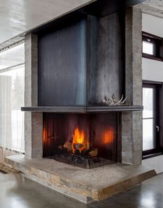 Fireplace hearth in Modern Mountain Home Home Fireplace, Fireplace Surrounds, Fireplace Design, Fireplace Ideas, Fireplace Hearth, Black Fireplace, Fireplace Inserts, Country Fireplace, Fireplace Kitchen