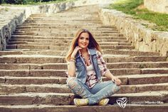Cheerful young woman posing - Cheerful young woman sitting on concrete stairs