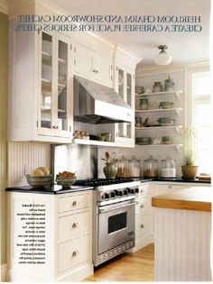 Beadboard backsplash. Black counters. Beadboard or board and batton on sides of cabinets. Darker objects high on wall. simple light fixture.