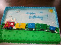 Paul's 1st Birthday - This cake was a half-sheet cake that was half yellow and half chocolate.  I frosted it with Extra Special Buttercream and the train and sun were mmf.  A smash cake matched the train theme for the day.