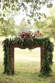 This rustic mantel featured on Waiting on Martha is the perfect DIY idea for an outdoor spring wedding. This beautiful display can be customized to match your flowers and decor, making it a gorgeous backdrop for photographs and the ceremony.