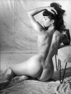 BETTIE PAGE REPRODUCTION VINTAGE ART BLACK & WHITE PRINT 1950S Bettie Page was a Playboy pin-up model and sex symbol of the 1950s. Her innocent, playful attitude made her a fashion icon. With her deep blue eyes and raven black hair with signature short bangs, Page became more than a