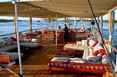 Boat Deck Lounge - Nile River Cruise by © Nour El Nil    'The Nile is Egypt's lifeline, the artery that runs through the entire country, from south to north. Only by setting adrift on it can you appreciate its importance and its beauty. Sailing is the slowest and most relaxing way to go, but even from the deck of a multistorey floating hotel you're likely to glimpse the magic.'