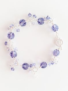 This bracelet is made with sterling silver and Swarovski crystals in Tanzanite - a light purple-blue color, and other 3 shades, gradually fading to clear crysta