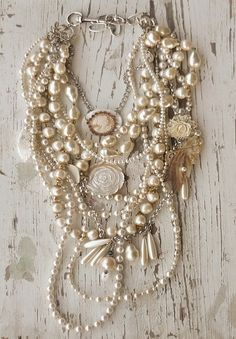 Beautiful strands of pearls and small ornaments in this necklace. Romantic!