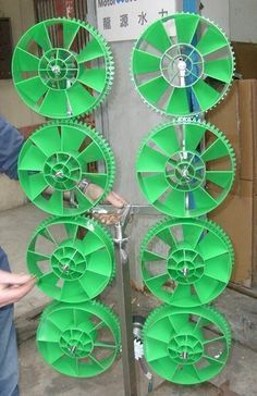 Each one opposes the next so the gears move together and each gear adds to the total energy captured at the bottom