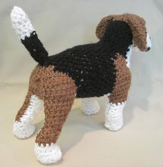 "**This is a PDF PATTERN only. This listing is not for a finished product**   *****AVAILABLE IN U.S. ENGLISH ONLY*****  This little cutie has nearly boundless energy. After hours of playing, all he wants to do is snuggle up in your lap and take a nice nap. He has the coloring and attributes of a realistic Beagle. He measures 11""L x 9""H x 4""W and is made from my own original pattern. He works up pretty quickly and uses only the simplest of stitches.  What you need to know: Chain, slip stitch…"