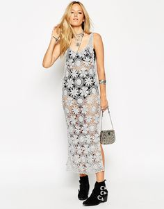 """ASOS Premium Hand Crochet Midi Dress In Metallic  Mid-weight crochet knit Metallic glitter finish Scoop neckline Thigh-high side splits Deep V-back Slim fit - cut closely to the body Machine wash 69% Viscose, 20% Polyester, 11% Metallised Fibres Model wears a UK 8/EU 36/US 4 and is 170cm/5'7"""" tall"""