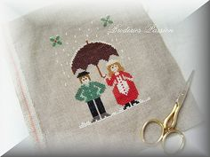 free pdf of a sweet winter Christmas cross stitch couple with umbrella in snow