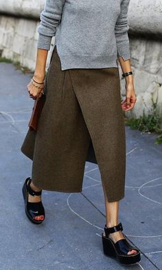 Grey sweater, olive wool wrap skirt, black Céline platforms