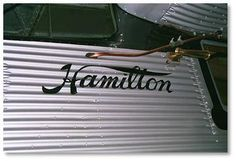 Hamilton Logo (1999) by C.W.Hitz: Hamilton H-47 (original Reg875H, Ser65) Vintage Hamilton re-engined and with floats and owned by Howard Wright III of Seattle, WA #boeing #metalplane #vintage #vintageairplane #vintageaircraft #anitqueaircraft #Hamilton  #875H #Seattle #kah #kenmoreair
