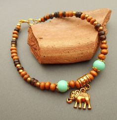 Great gift for ethnic lovers. Anklet with wooden beads and an elephant – a unique product by Nuvola-Bianca via en.DaWanda.com #earthycolors
