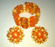 "Orange Wire Wrap Bracelet and Clip On Earrings wire wrap bracelet and clip on earrings bright shades of orange plastic beads. Signed Beaujewels. Earrings measure 1 1/4"" in diameter. $30.00 Free shipping in the US. Questions? PM me via FB. PayPal Only."