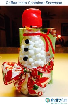 This is a guide about making a Coffee Mate container snowman. A Coffee Mate container is the perfect shape for making a cute snowman that can be filled with treats for a gift or used as a decoration. Plastic Coffee Cans, Plastic Coffee Containers, Recycling Containers, Recycling Ideas, Frugal Christmas, Holiday Crafts, Christmas Goodies, Holiday Ideas, Christmas Ideas
