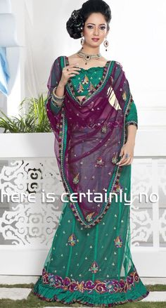 $63.13Plum And Jade Green Net Lehenga Saree 12903 With Unstitched Blouse
