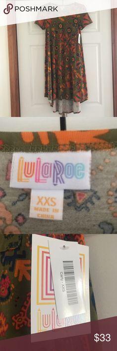 LuLaRoe XXS Carly LuLaRoe XXS Carly. NWT. Pet and Smoke Free home. LuLaRoe Dresses High Low