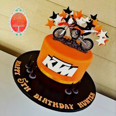 Chocolate mud KTM motorbike cake in the KTM orange, black and white theme.    Original design by: onceuponacake.com.au  Cakes from Bella Capella Culinary Delights in Capella, Queensland's Central Highlands, Australia. Contact: bellacapella@bigpond.com www.facebook.com/bellacapellaculinarydelights