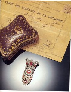 Diamants de la Couronne: A ruby and diamond brooch by Bapst, with gilt red leather case bearing the cypher of Louis XIV, and papers from the 1887 auction of the French Crown Jewels.