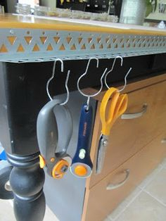 DIY:  Brilliant Organizing Idea - metal corner brackets (file sharp edges!), used to reinforce drywalled corners, were attached to a work table & are used to organize tools, by hanging them with inexpensive shower curtain hooks. Great for the craft room, garage, etc.