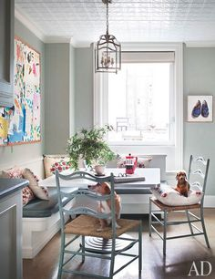 I love the bulletin board behind the table along with everything else.   Ali Wentworth and George Stephanopoulos's New York Apartment chairs by David Iatesta in the breakfast area; the hanging lantern is by Vaughan.