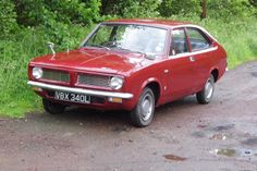 1973 Morris Marina 1.3 Deluxe Coupe in purple (or 'black tulip' according to BL) also on an L plate.