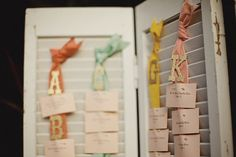 Hanging the cards from the ribbons, which are hung from a shutter... adorable