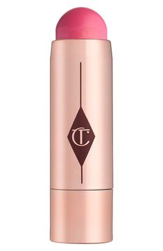 How to use the Charlotte Tilbury 'Beach Stick': Simply twist up the color and apply straight to skin from the bullet and blend with your fingers for a fresh, youthful look of year-round summer.