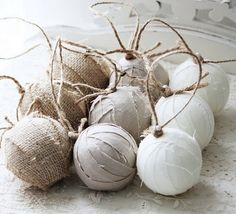 Cut rustic fabric into fine strips then cover regular Christmas baubles glue-gunning at each end with a loop of string
